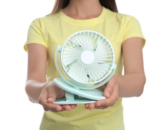 Woman with portable fan on white background, closeup. Summer heat