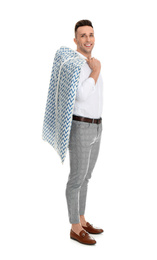 Man holding garment cover with clothes on white background. Dry-cleaning service