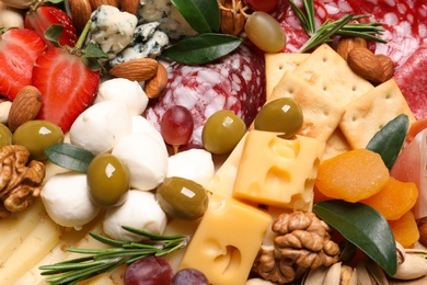 Different sorts of cheese, olives and other products, closeup