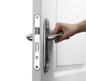 Woman opening wooden door on white background, closeup