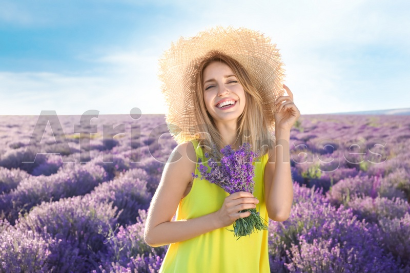 Young woman with bouquet in lavender field