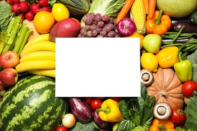Blank card with assortment of organic fresh fruits and vegetables as background, top view. Space for text