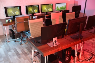 Internet cafe with modern computers for playing video games