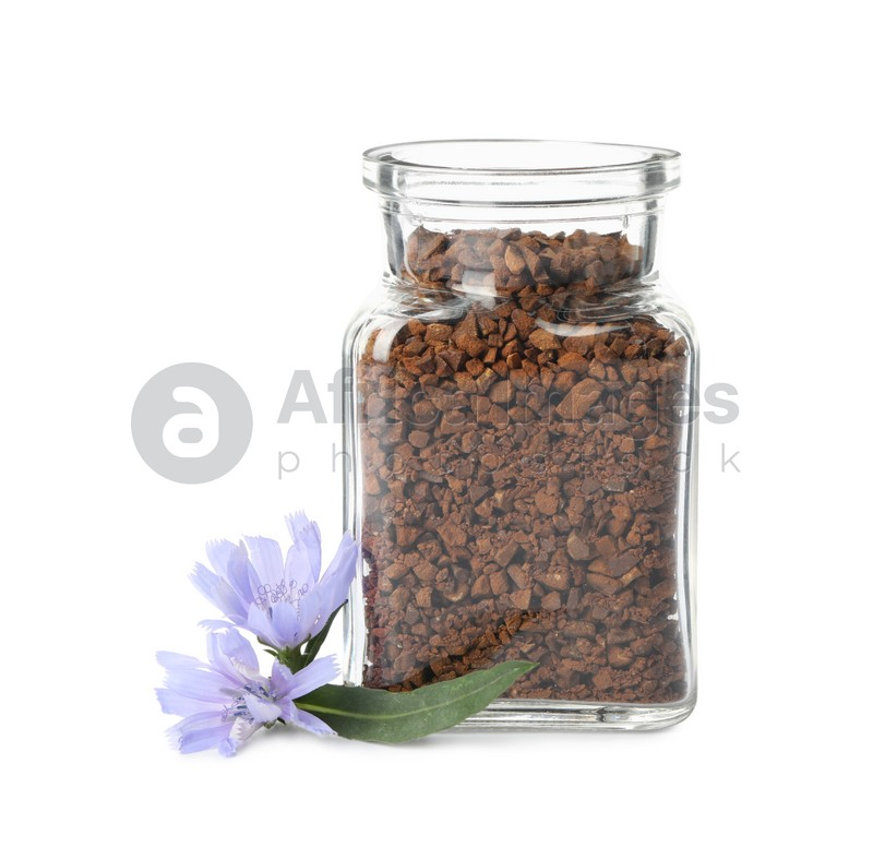 Jar of chicory granules and flowers  on white background