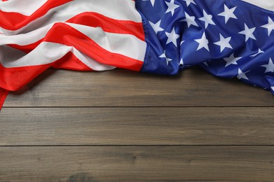 American flag on wooden table, top view with space for text. Memorial Day
