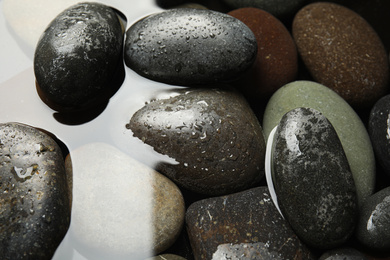 Pile of stones in water as background, closeup. Zen lifestyle