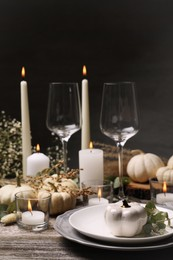 Beautiful autumn place setting and decor on wooden table