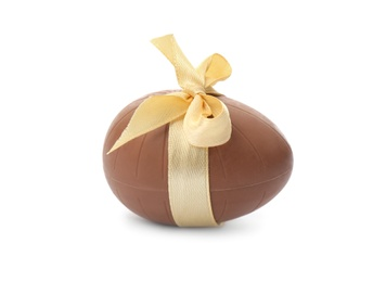 Chocolate egg with beige bow isolated on white