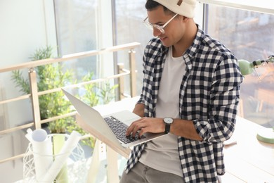 Freelancer working on laptop in home office
