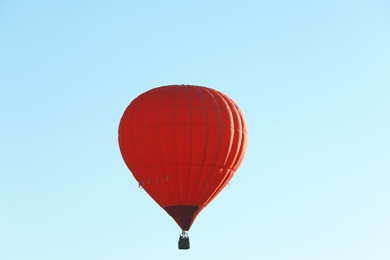 Colorful hot air balloon flying in blue sky