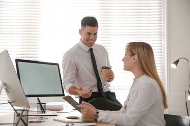 Man flirting with his colleague during work in office