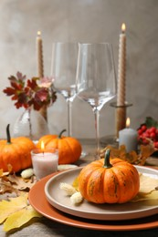 Beautiful autumn place setting and decor on table