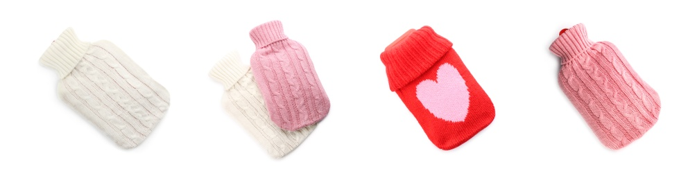 Set of hot water bottles with knitted covers on white background. Banner design