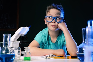 Child in laboratory after explosion. Dangerous experiment