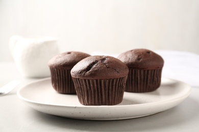 Delicious chocolate cupcakes on white table, closeup