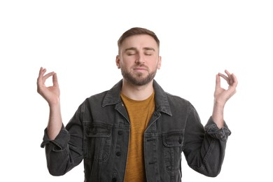 Young man meditating on white background. Personality concept