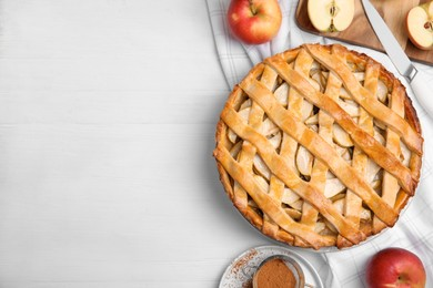 Delicious traditional apple pie on white table, flat lay. Space for text