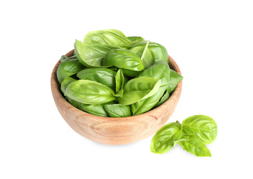 Fresh green basil leaves in wooden bowl isolated on white