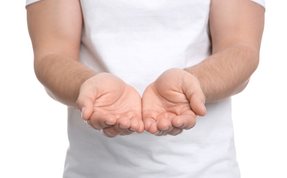 Man with open hands on white background, closeup