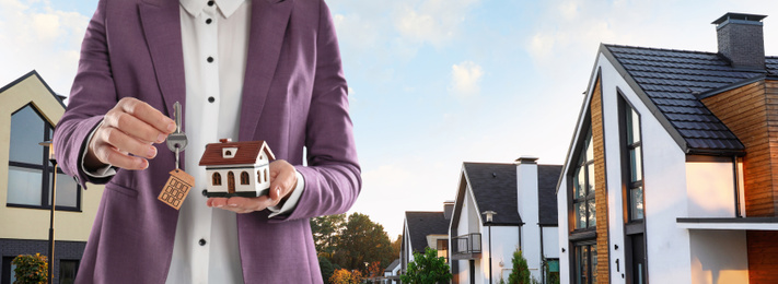 Real estate agent with model against modern houses, space for text. Banner design, closeup