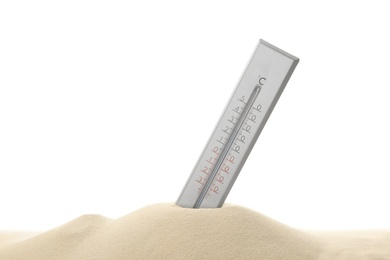 Weather thermometer in sand against white background