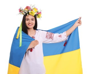 Young woman in national clothes with flag of Ukraine on white background