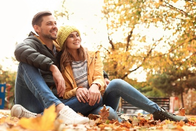 Lovely couple spending time together in park. Autumn walk