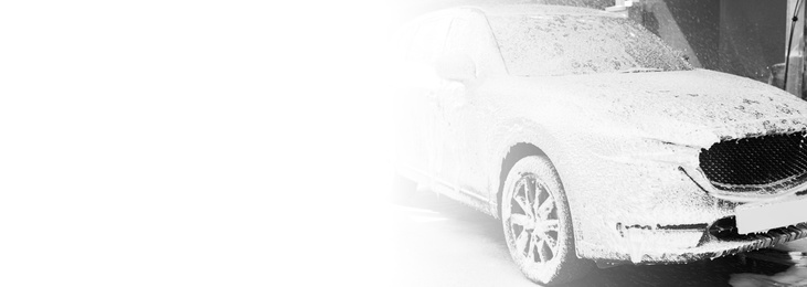 Auto with foam at car wash, space for text. Banner design