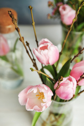 Beautiful bouquet with spring pink tulips on table, closeup