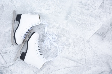Pair of figure skates on ice, flat lay with space for text. Winter outdoors activities