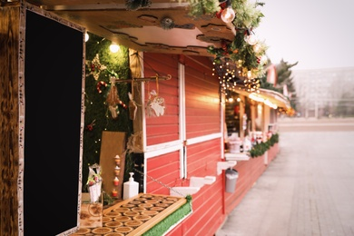 Bright Christmas fair stalls with decor outdoors