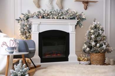 Fireplace in living room decorated for Christmas