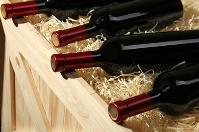 Wooden crate with bottles of wine, closeup