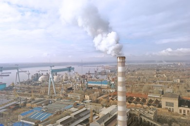 Polluting air with smoke, aerial view of industrial factory. CO2 emissions