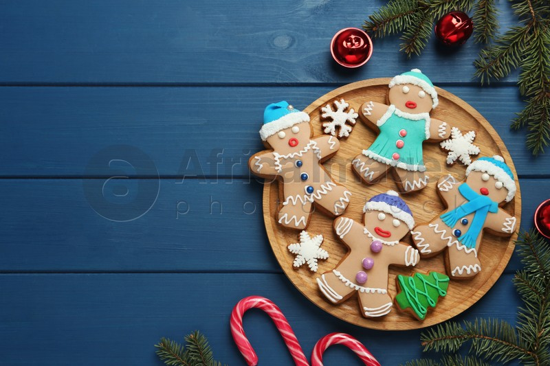 Flat lay composition with delicious Christmas cookies on blue wooden table, space for text