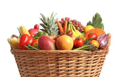 Basket with assortment of fresh organic fruits and vegetables on white background, closeup