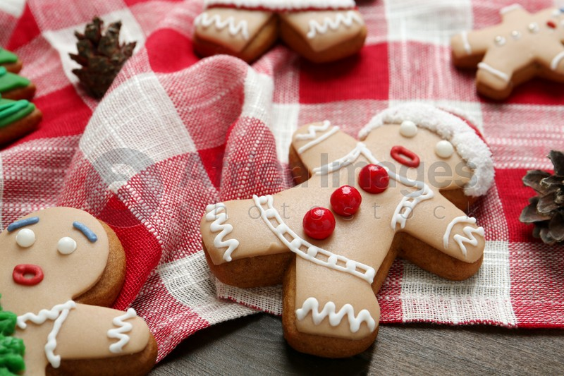 Delicious Christmas cookies and pine cones on wooden table, closeup