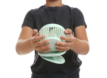 Little boy with portable fan on white background, closeup. Summer heat