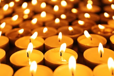 Many burning candles as background. Memory day