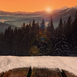 Wooden surface and beautiful view of winter landscape