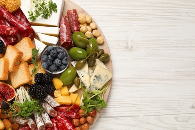 Different tasty appetizers on white wooden table, top view. Space for text