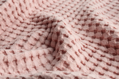 Texture of soft light pink fabric as background, closeup