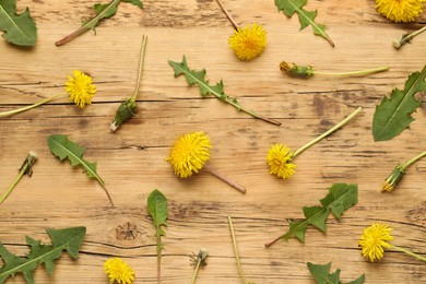 Flat lay composition with beautiful yellow dandelions on wooden table