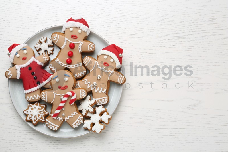 Delicious Christmas cookies on white wooden table, top view. Space for text