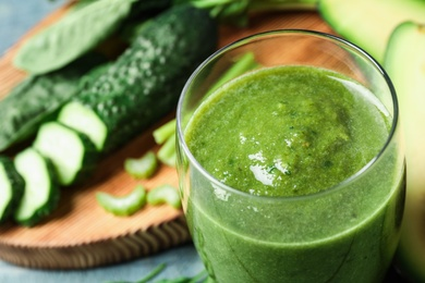 Delicious fresh green juice in glass, closeup. Space for text
