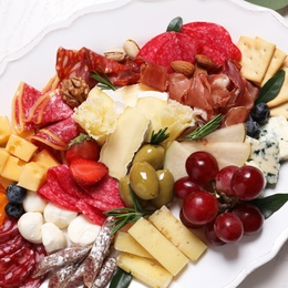 Plate full of tasty assorted appetizers, closeup