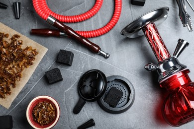 Flat lay composition with parts of hookah on grey table