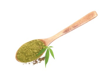 Wooden spoon with hemp protein powder and fresh leaf on white background, top view
