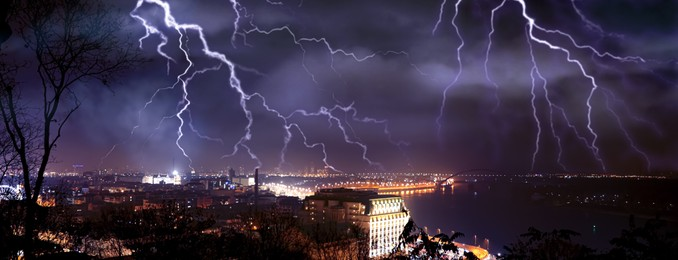 Dark cloudy sky with lightning over city, banner design. Stormy weather