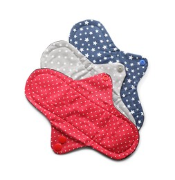 Many cloth menstrual pads on white background, top view. Reusable female hygiene product